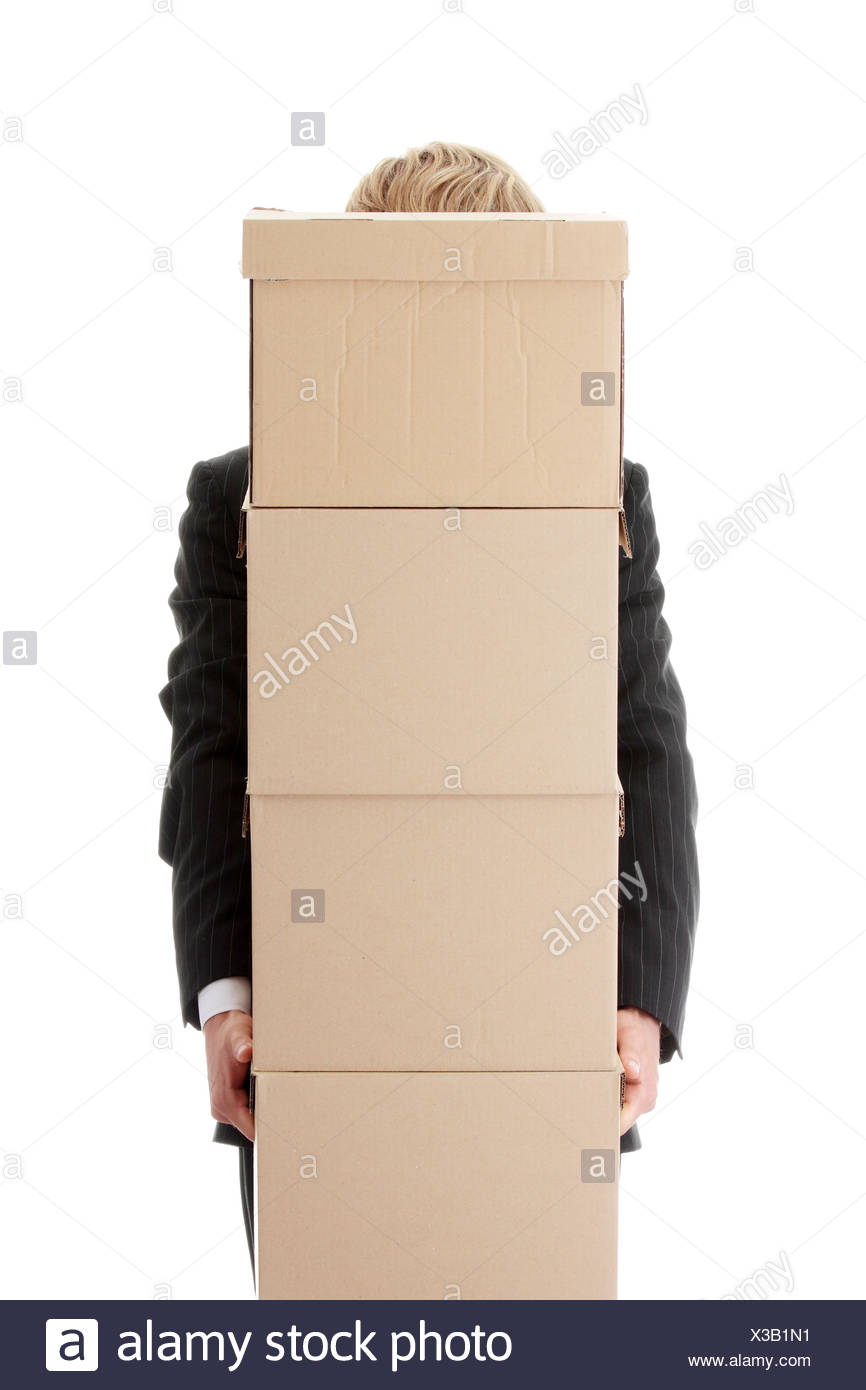 businessman with stacked boxes isolated on white stock photo