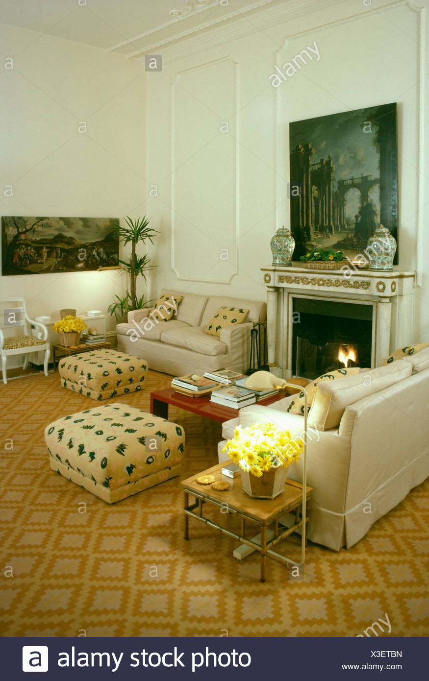 Merveilleux Sofas And Upholstered Patterned Stools In Livingroom With Fireplace And  Patterned Yellow Carpet