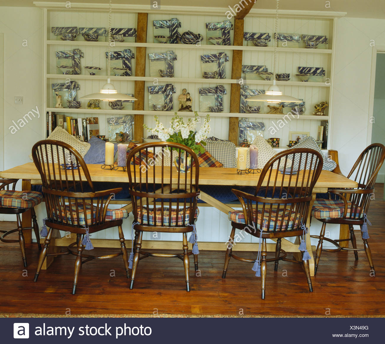 Antique Windsor Chairs And Simple Pine Table In Country Dining Room With Blue White China Frames On Shelves