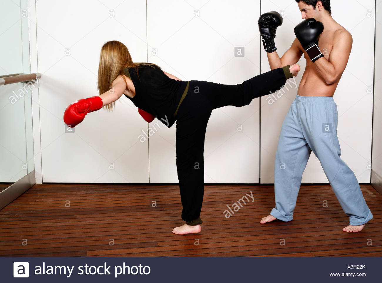 straight right hand punch of active tae bo and side kick stock photo