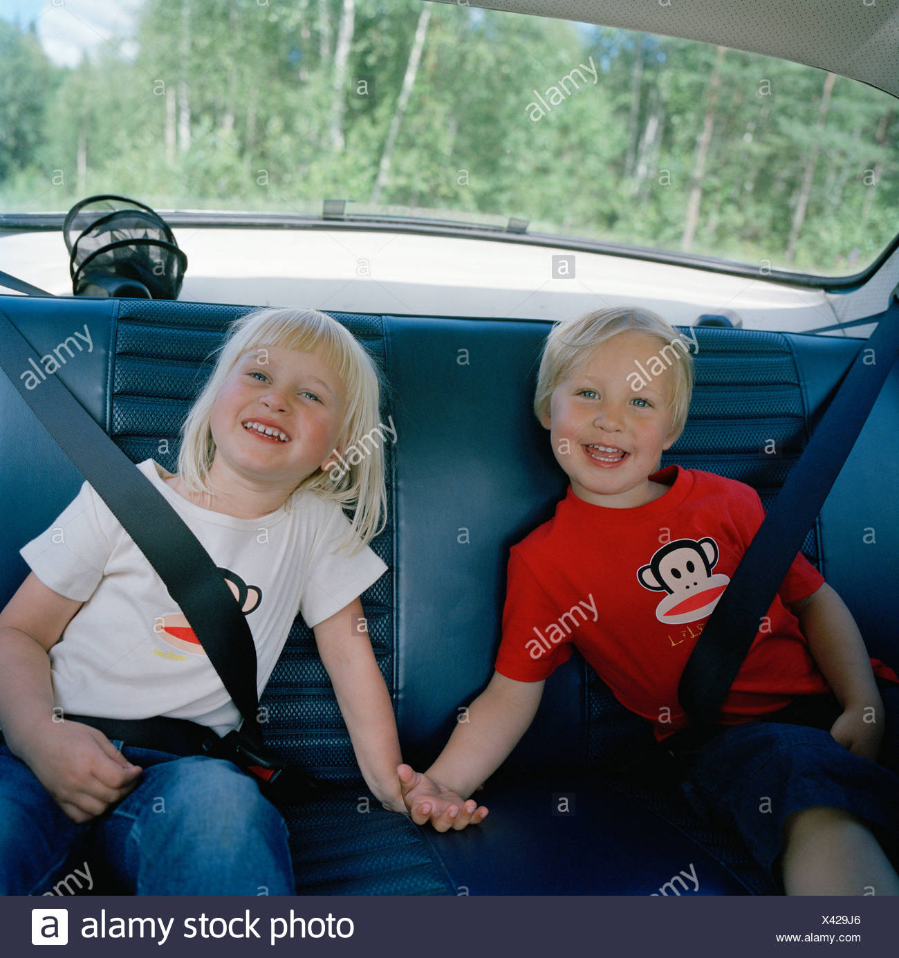 Two Children In The Back Seat Sweden