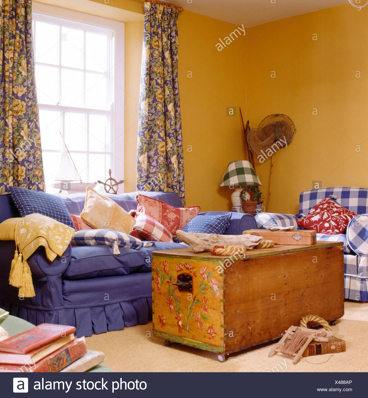 Beau Painted Chest And Blue Sofa In Yellow Coastal Living Room With Blue+yellow  Floral Curtains