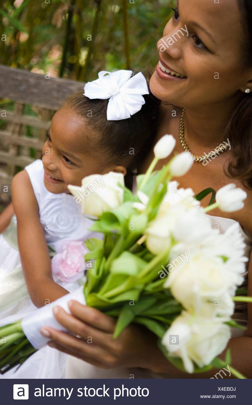 Closeup of happy african american bride holding bouquet with flower closeup of happy african american bride holding bouquet with flower girl izmirmasajfo