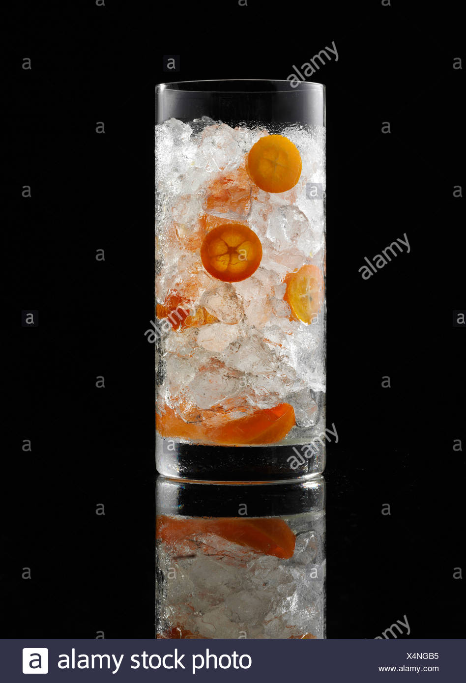 glass prepared for a cocktail with ice cubes and decorations stock