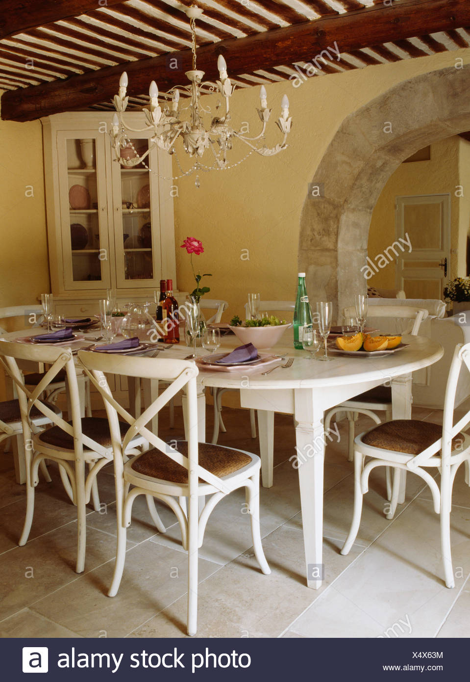 French Country Dining Room Painted Furniture With Simple Cream Metal Chandelier Above Painted Chairs And Table In French Country Dining Room