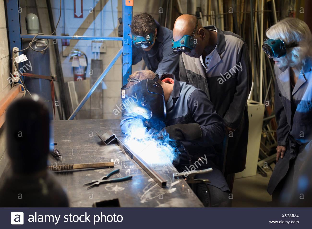welders welding in workshop stock photo 278806644 alamy