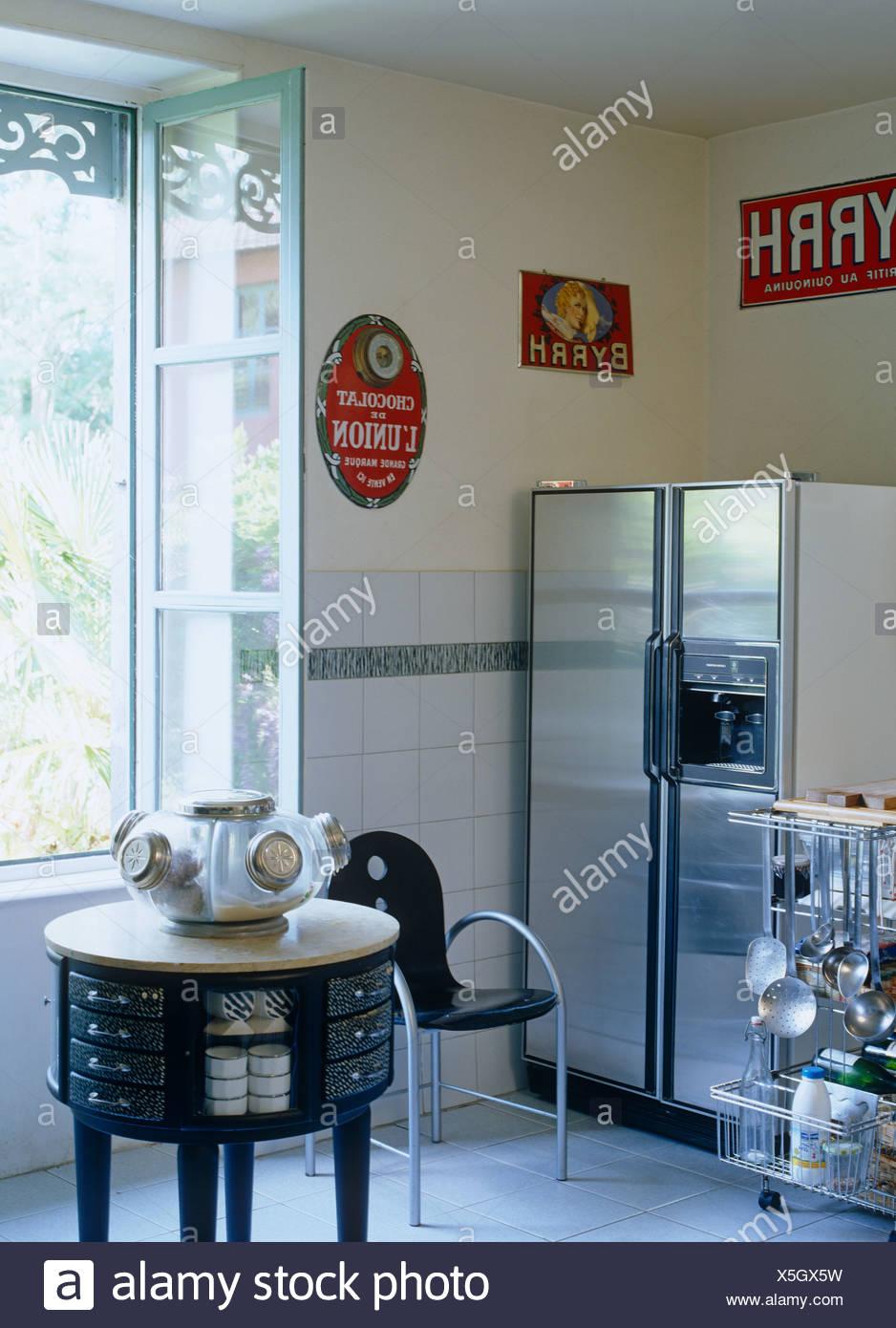 Stainless steel larder fridge in corner of modern French kitchen ...