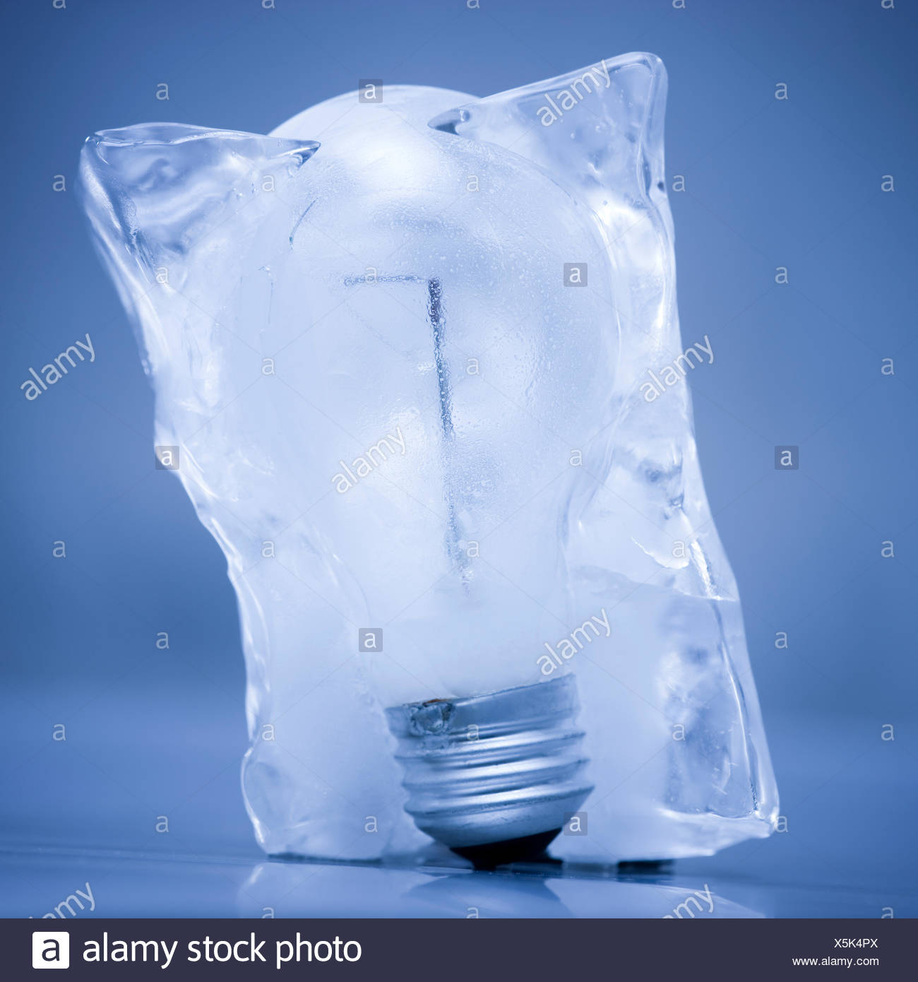 light bulb frozen in a block of ice stock photo 278860034 alamy