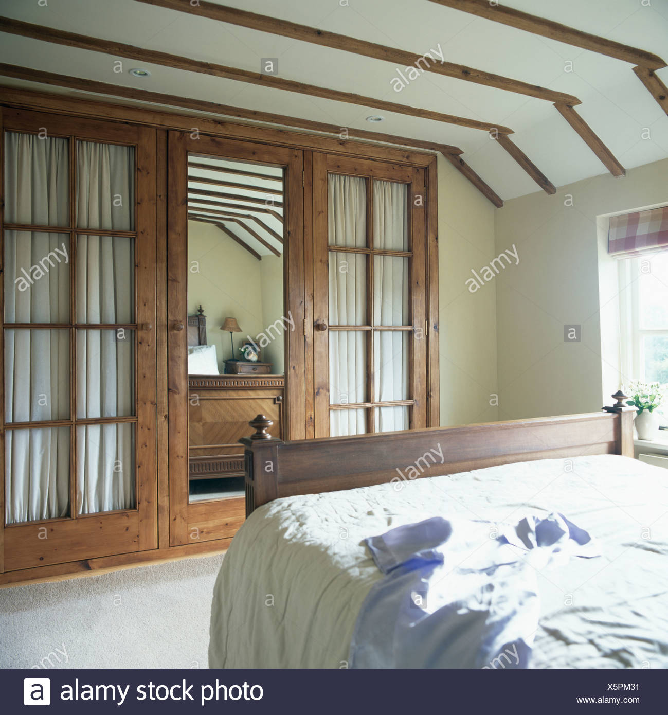 Built In Cupboards With Mirror And Glass Panelled Doors In Country
