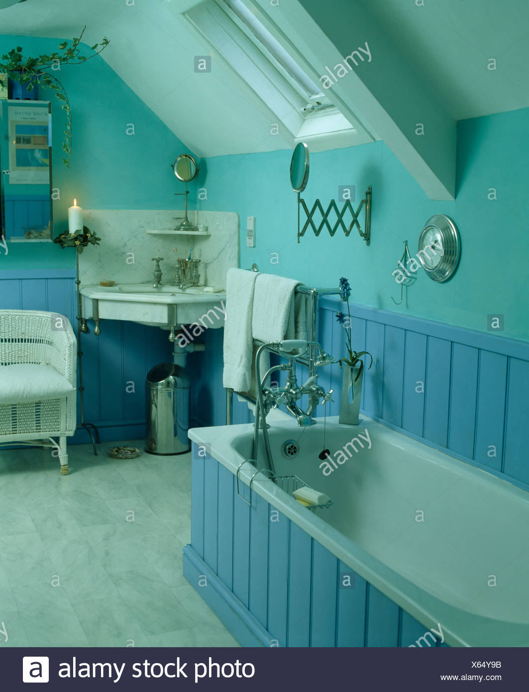 Blue panelled bath in pastel turquoise bathroom Stock Photo ...
