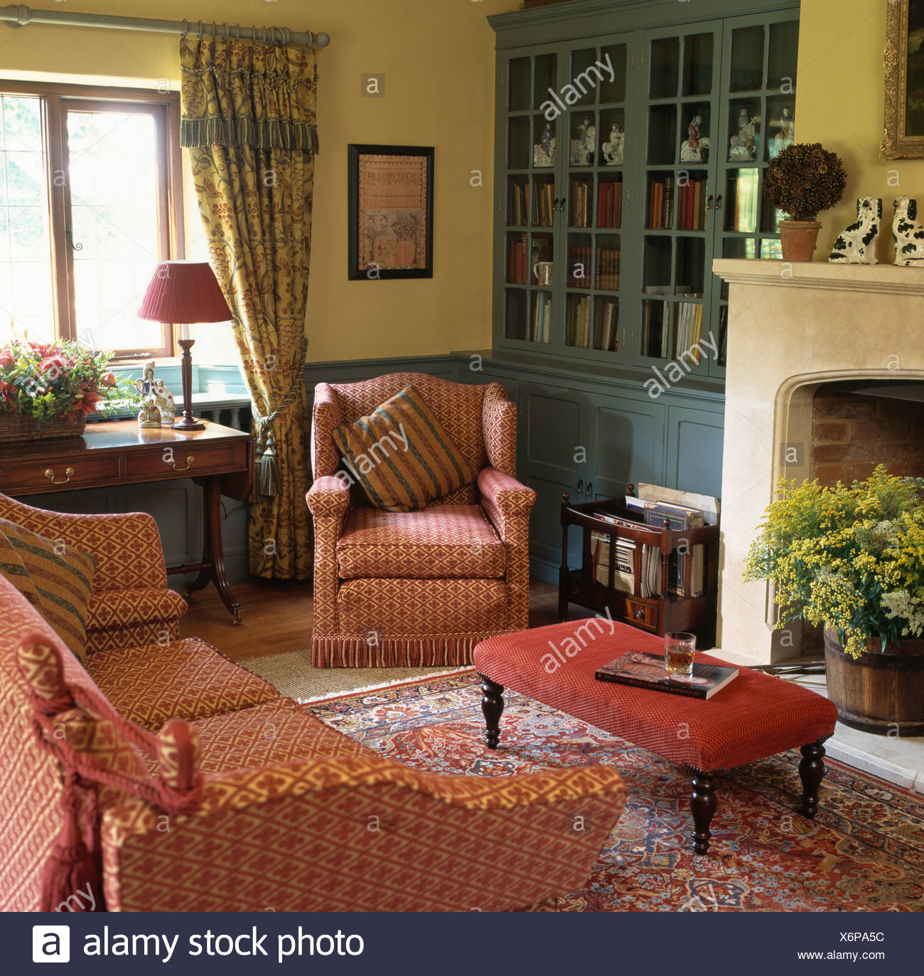 Superbe Patterned Red Sofa And Armchair In Livingroom With Pale Yellow Walls And  Grey Blue Alcove Cupboard