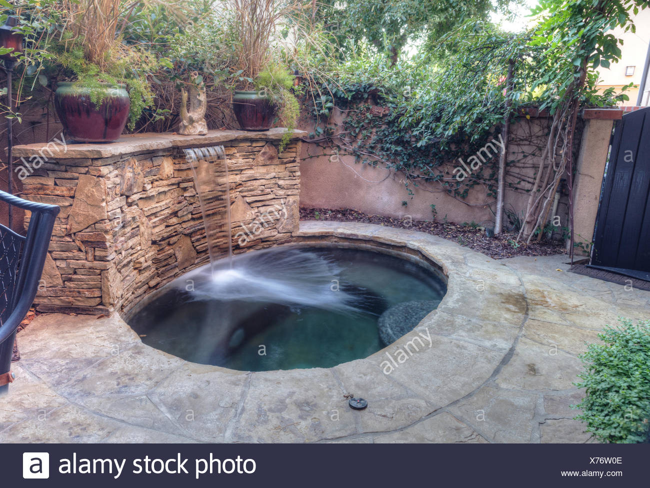 Oval hot tub spa with waterfall Stock Photo: 279819806 - Alamy