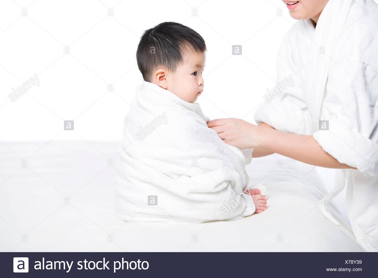 Mother Wrapping Baby In Blanket Stock Photo 279865357 Alamy