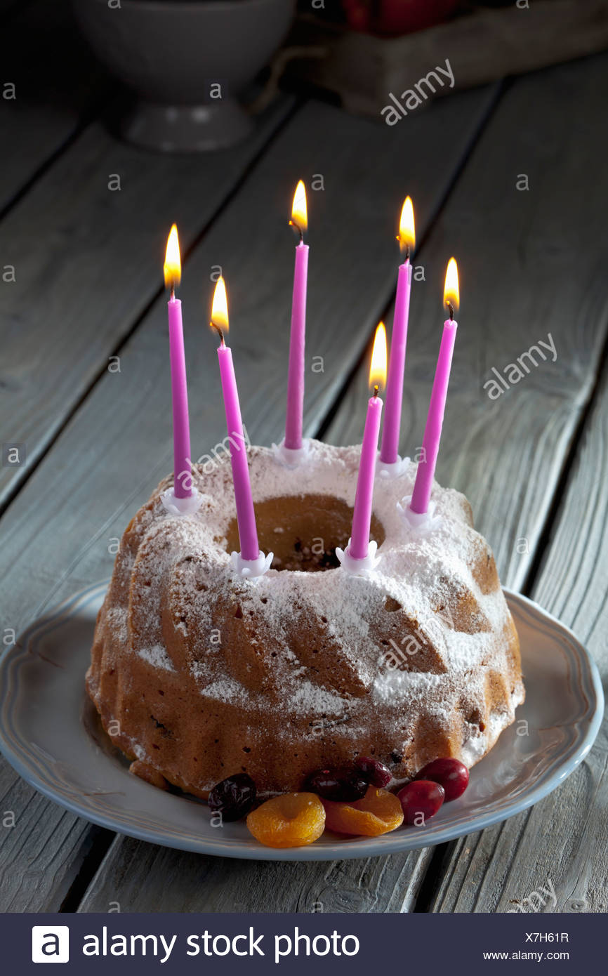 Selfmade Birthday Cake With Six Lighted Candles On Plate Stock Photo