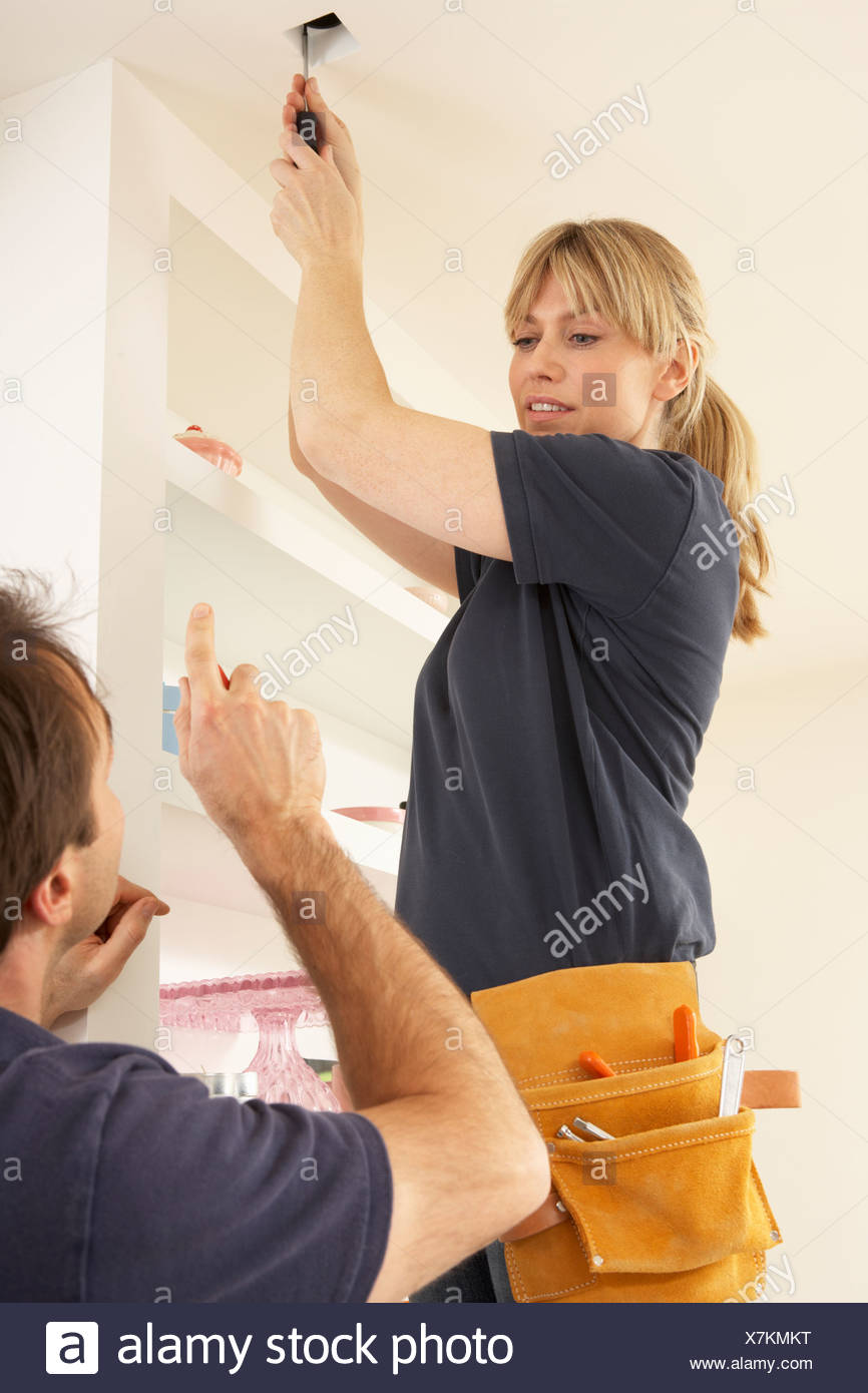Electrician Teaching Apprentice To Install Light Fitting In Home Wiring A