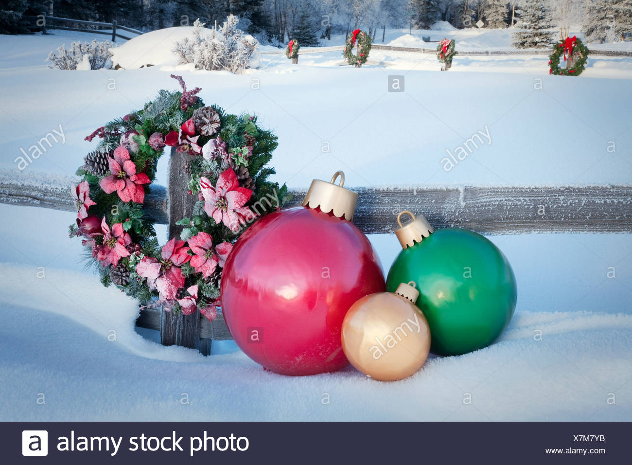 split rail fence decorated with christmas wreaths and decorations anchorage alaska