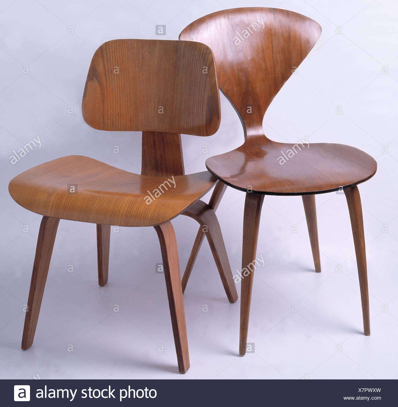 Close Up Of Norman Cherner Chair With Charles Eames DCW Molded Plywood Chair