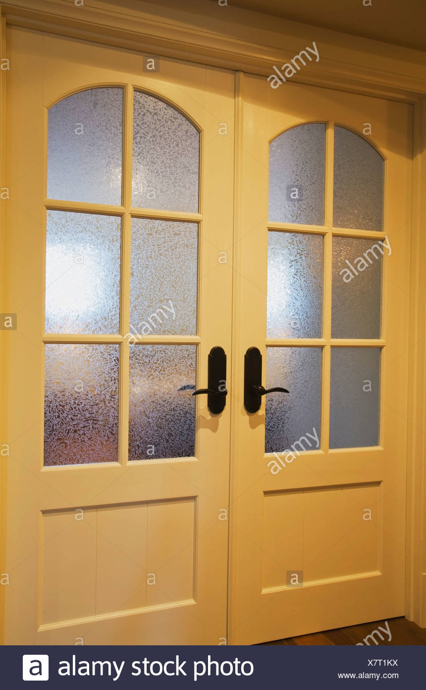 French Doors With Frosted Glass Panels In A Home Stock Photo