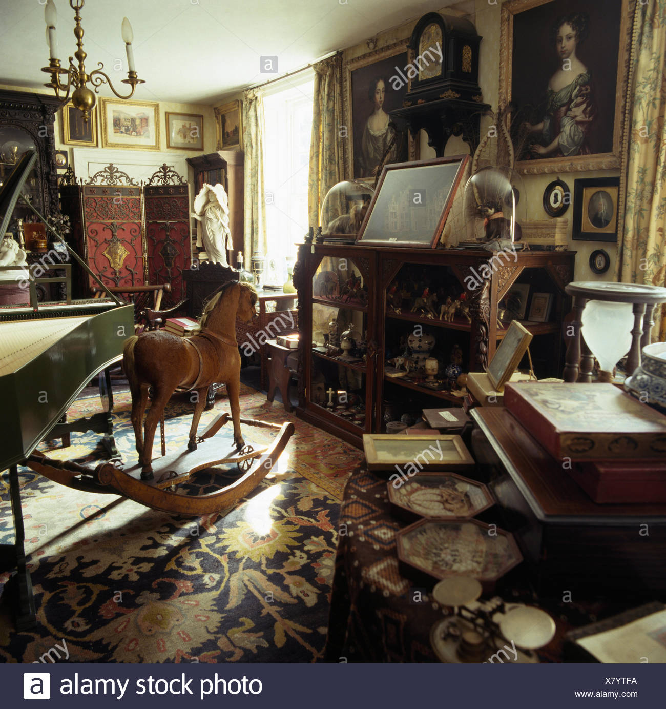 Rocking Horse In Study With Antique Furniture In Jacobean Rectory