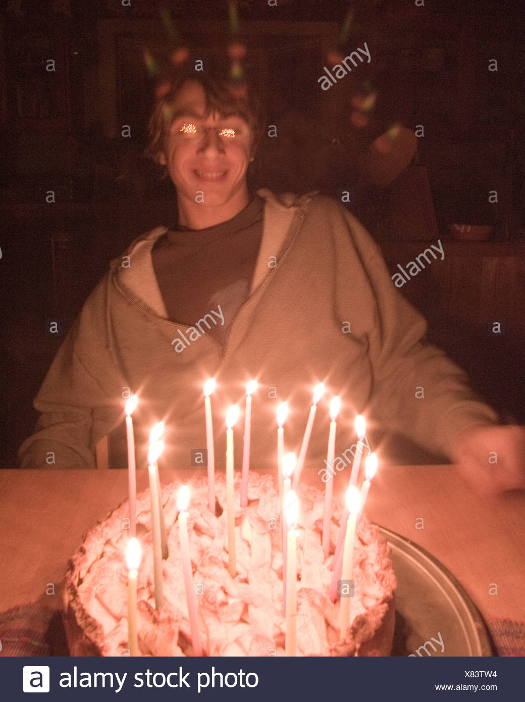 A Boy With His Birthday Cake And 16 Candles California Stock Photo