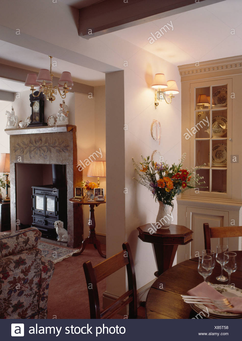 Wall lights in small dining room with open doorway to cottage living ...