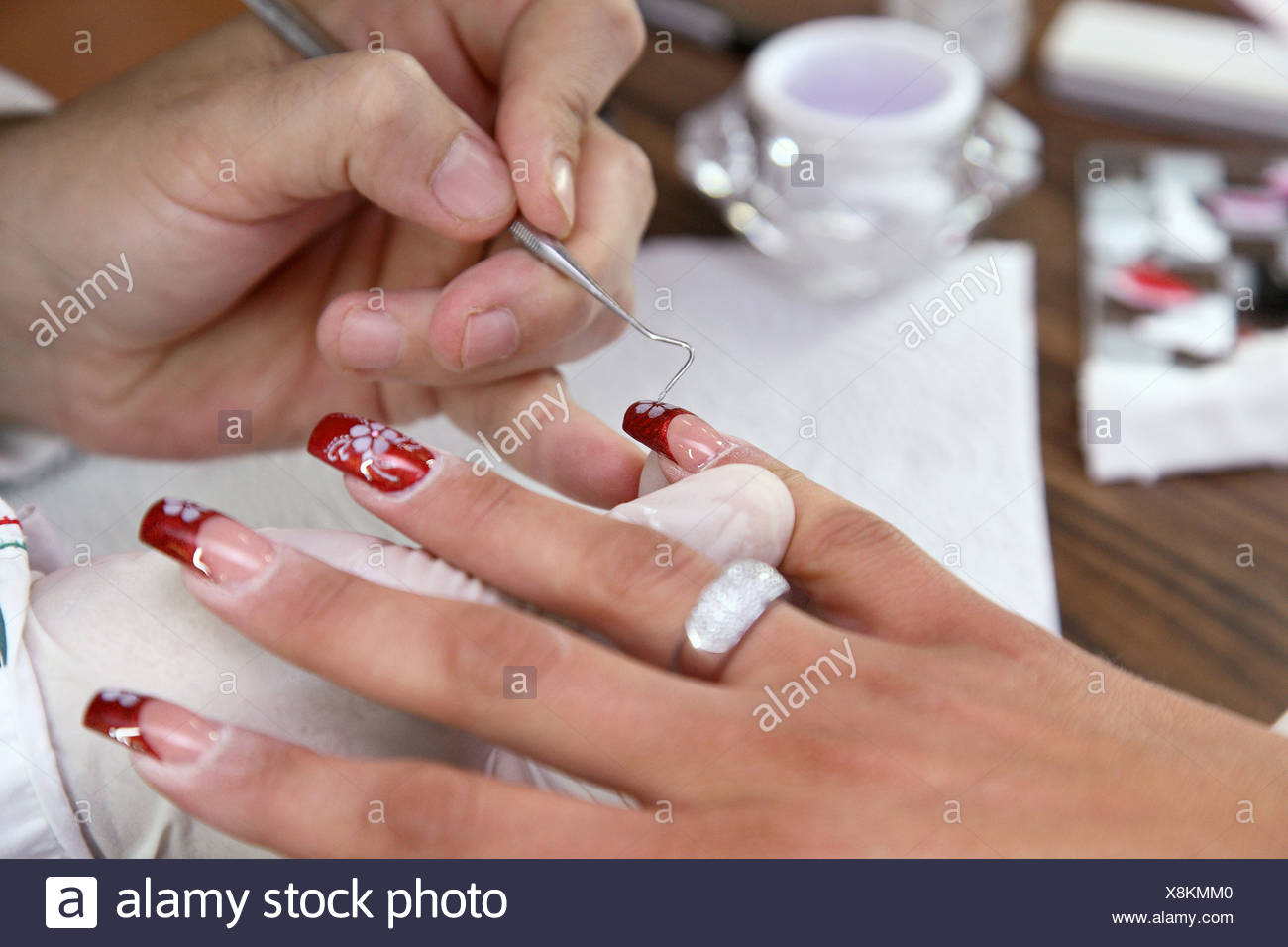 Berlin Germany A Nail Designer Decorated Nails With Glitter Stock