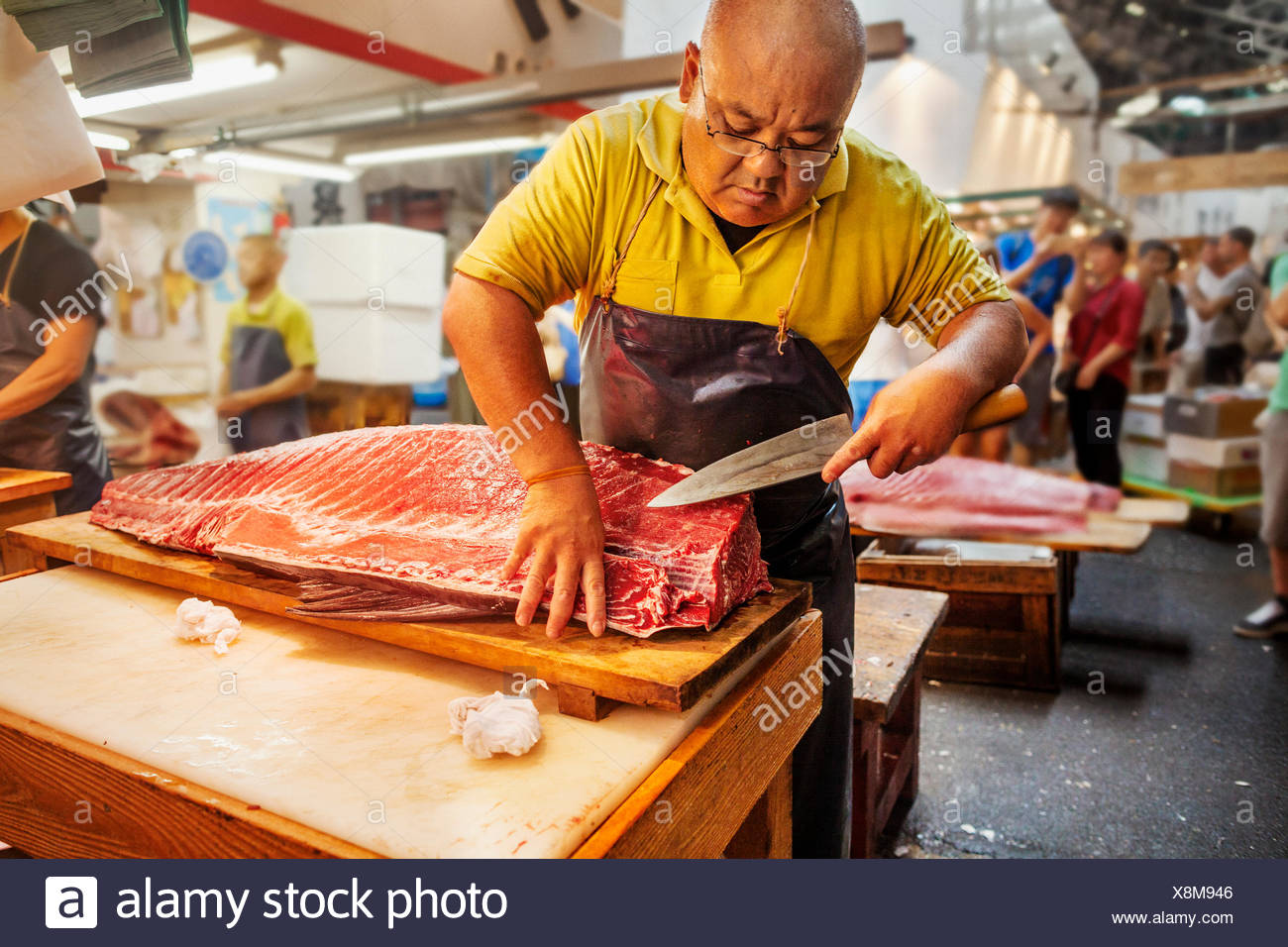 A Traditional Fresh Fish Market In Tokyo A Fishmonger Working