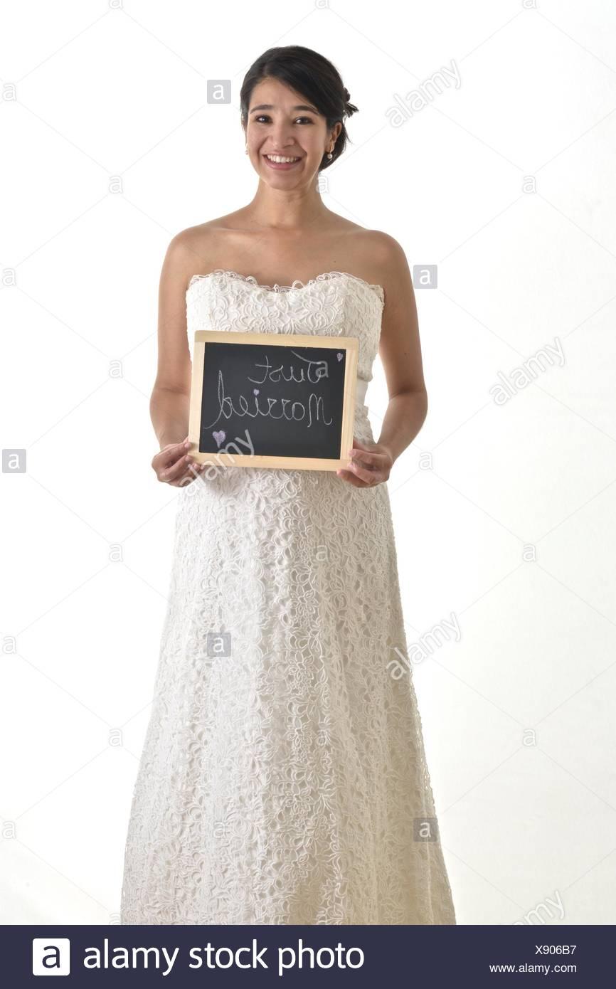 A hispanic bride wearing her white wedding dress stock photo a hispanic bride wearing her white wedding dress junglespirit Choice Image