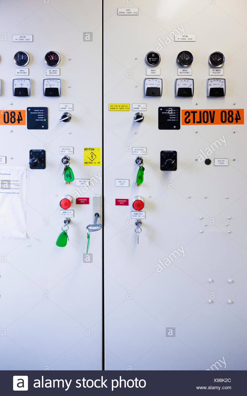 Buttons and switches on a diesel generator control panel, electrical ...