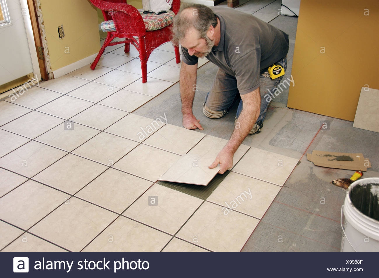Putting Down Underflooring And Mastic And Tile On Remodeling Of