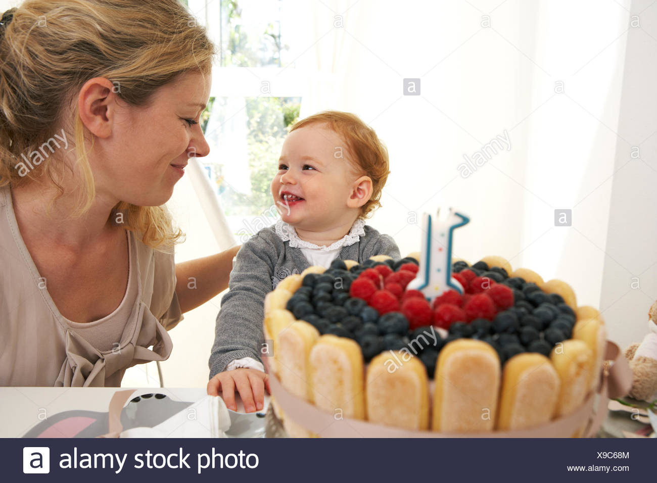 Mother And Daughter Celebrating Little Girls First Birthday With