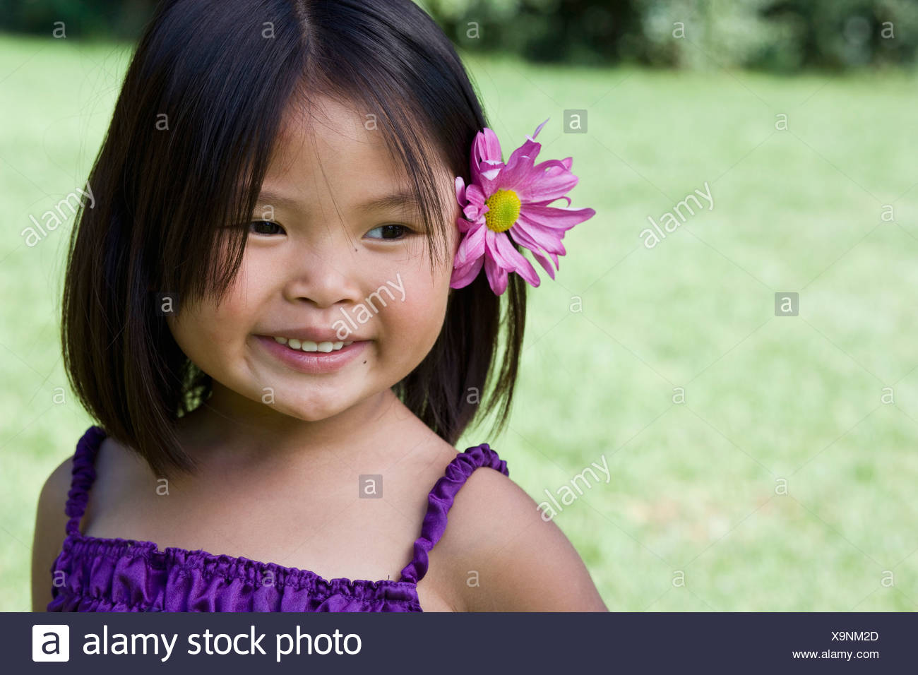 A Young Girl With A Flower Behind Her Ear Stock Photo 281374533 Alamy