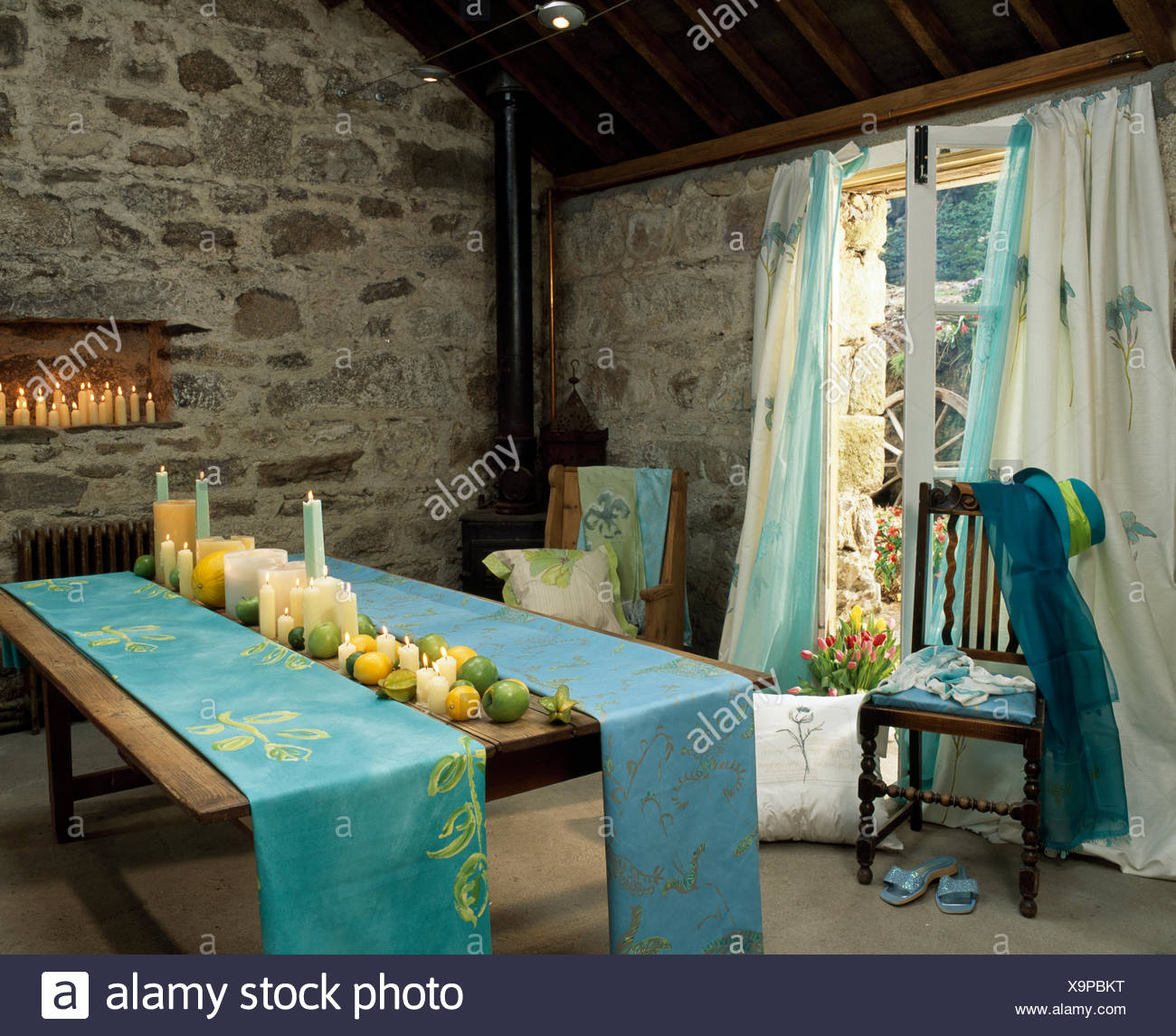 Hand Painted Table Runners On Dining Table With Co Ordinating Curtains On  The Window In A Stone Barn