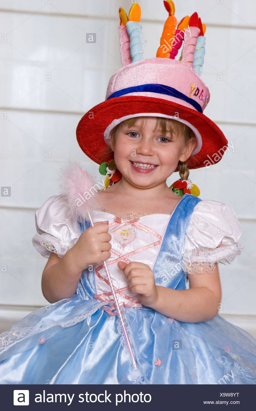 Little Girl Dressed Up In Princess Dress And Birthday Cake Hat Stock