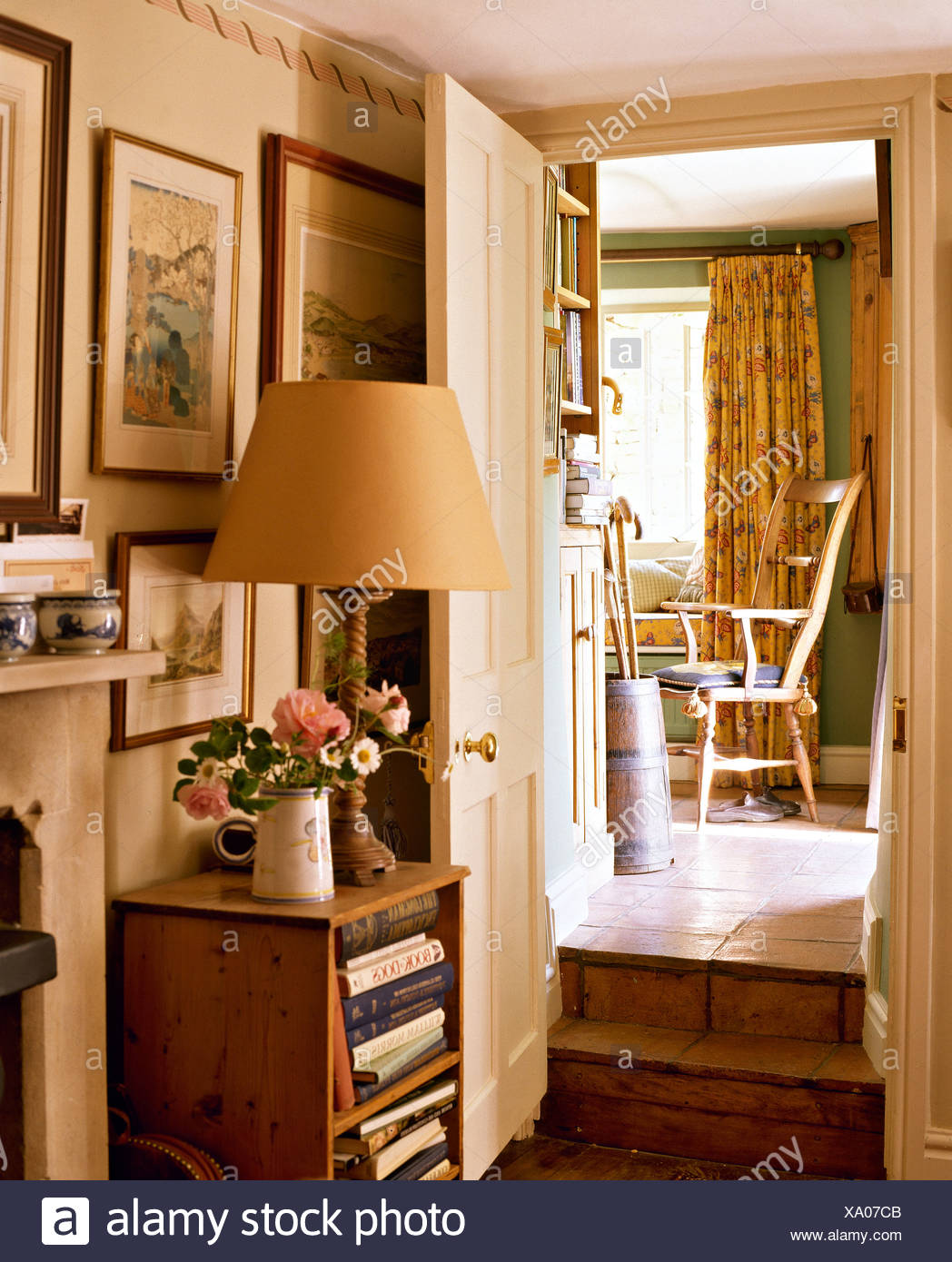Lamp On Small Pine Shelves In Cottage Hall With Steps Up To Doorway To  Dining Room