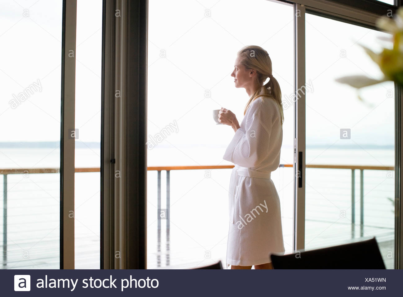 Woman Looking Out Glass Door Stock Photo 281623713 Alamy