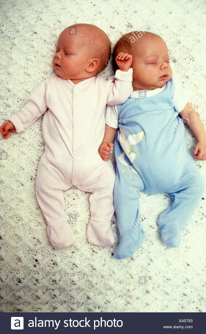 newborn non identical male and female twin babies stock photo