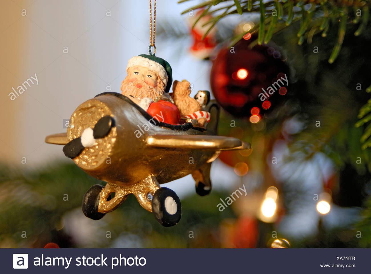 christmas tree decorations santa claus sitting in a plane - Santa Claus Christmas Tree Decorating Ideas