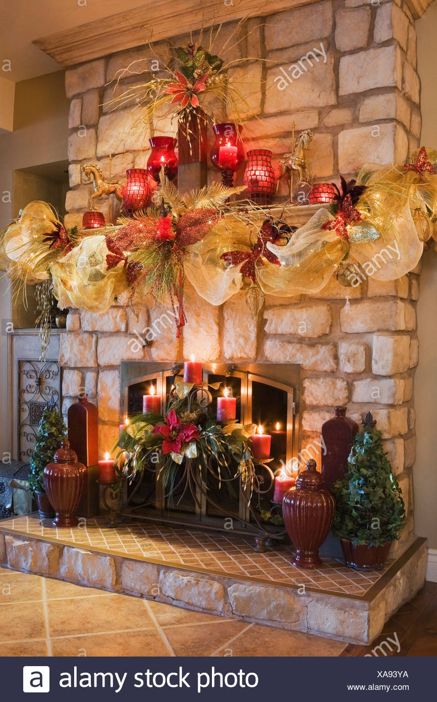 fireplace mantle with illuminated christmas decorations quebec canada - Christmas Decorations Canada
