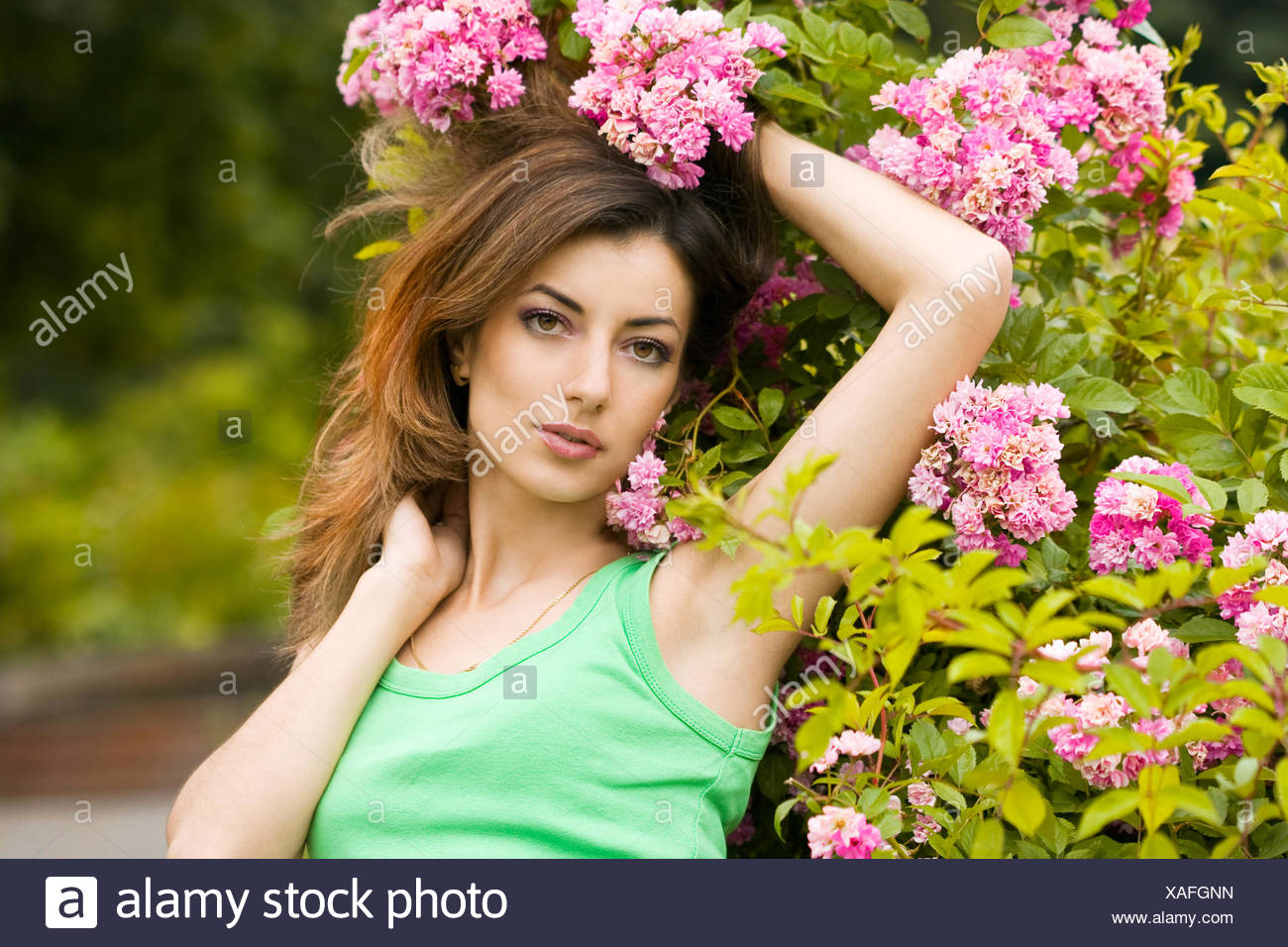 Beautiful woman in garden with flowers stock photo 281854881 alamy beautiful woman in garden with flowers izmirmasajfo