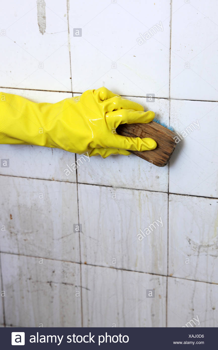 Cleaning of dirty old tiles in a bathroom Stock Photo: 281907954 - Alamy