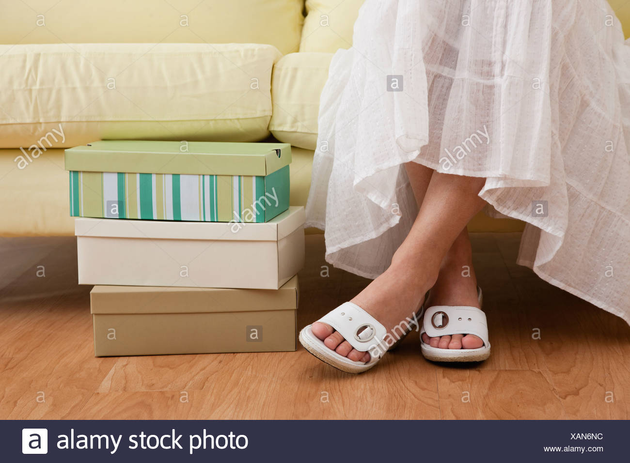 Usa Illinois Metamora Woman Sitting On Sofa In Shoe Store Low