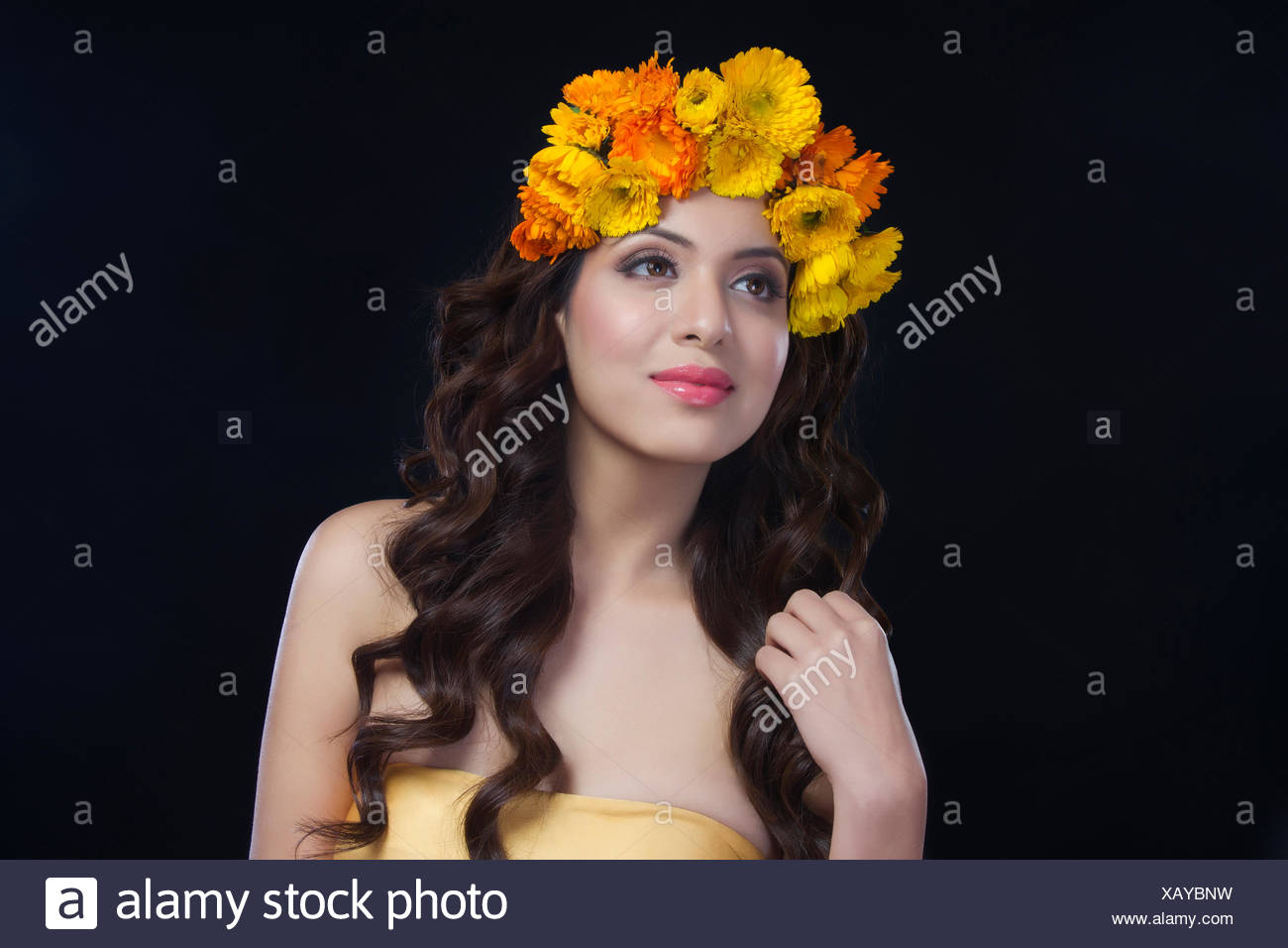 Portrait of a beautiful woman with flowers in her hair stock photo portrait of a beautiful woman with flowers in her hair izmirmasajfo Image collections