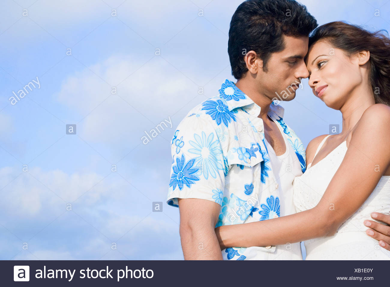 side profile of a young couple romancing stock photo 282160059 alamy