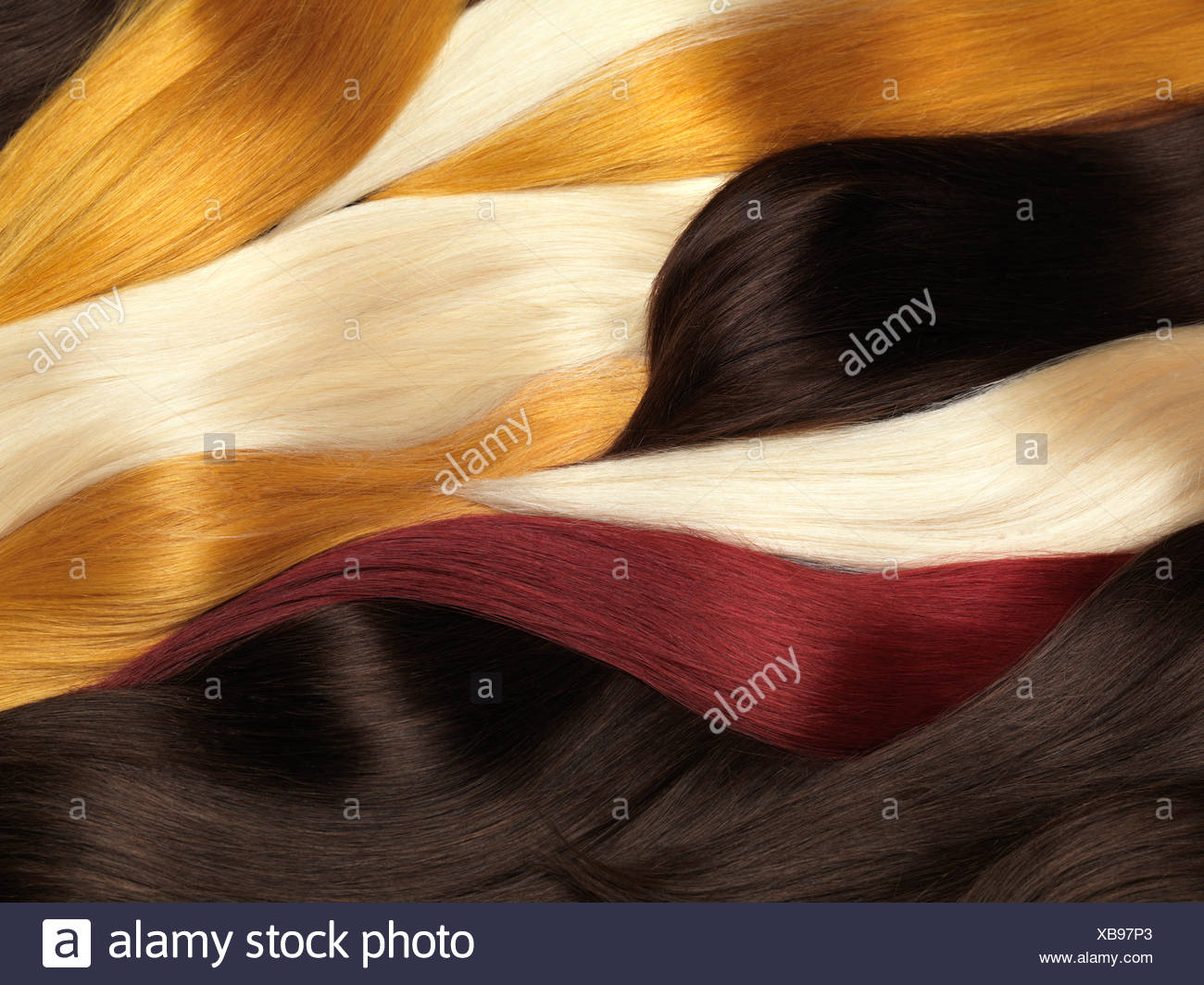 Natural Human Hair Extensions Of Different Colors Stock Photo