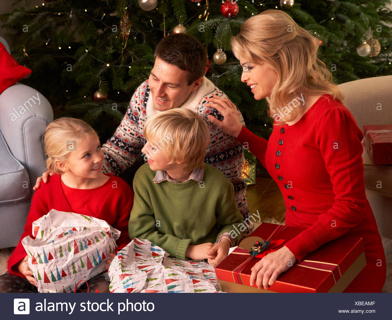 Family Opening Christmas Gifts At Home Stock Photo: 282442847 - Alamy