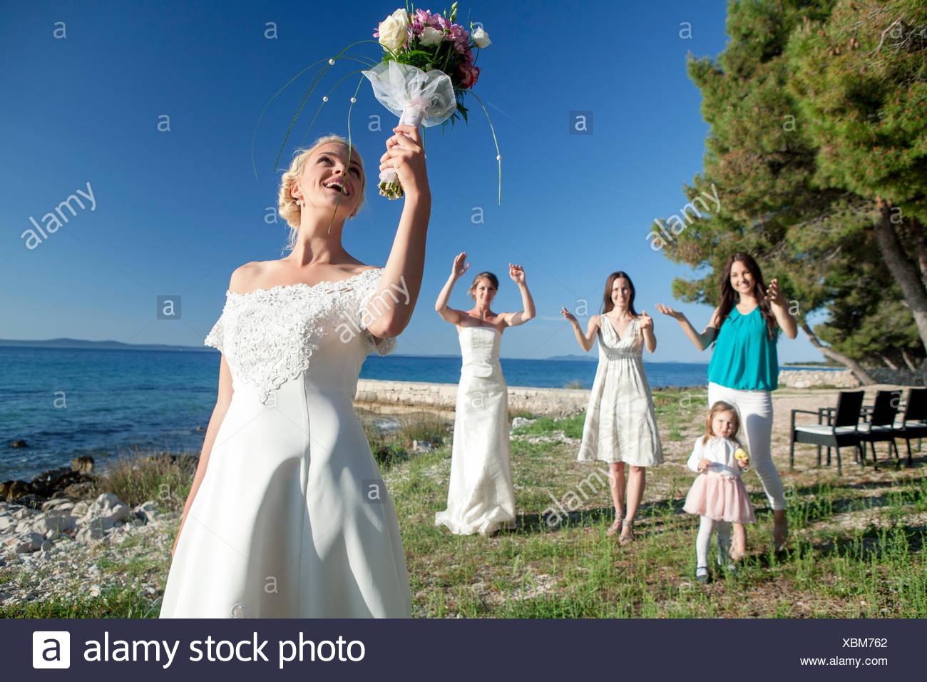 Bride Throwing Bouquet At Wedding Reception Stock Photo 282571802