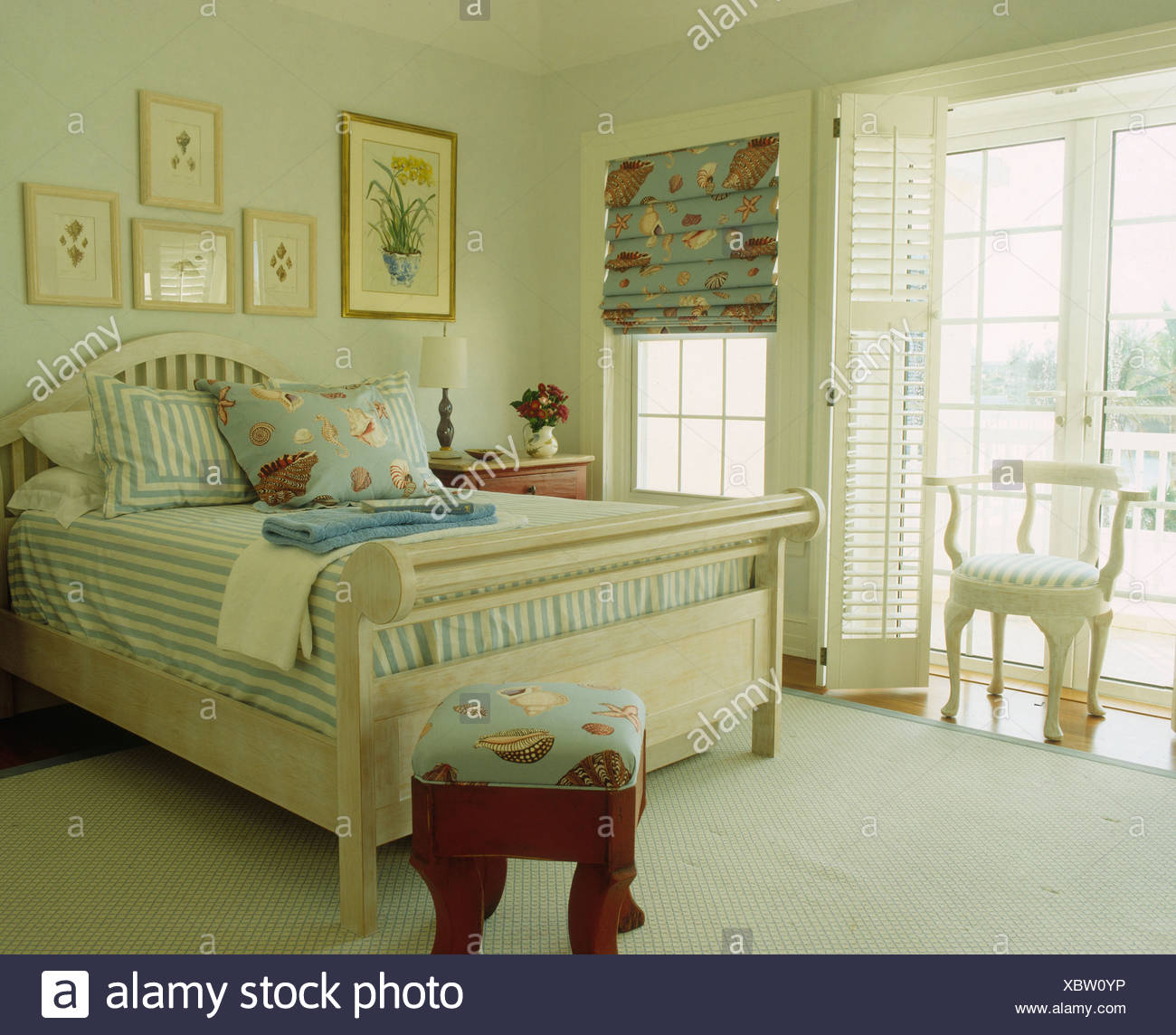 Striped Blue Cover On Pale Wood Bed In Bermudan Bedroom Plantation Shutters  On French Doors
