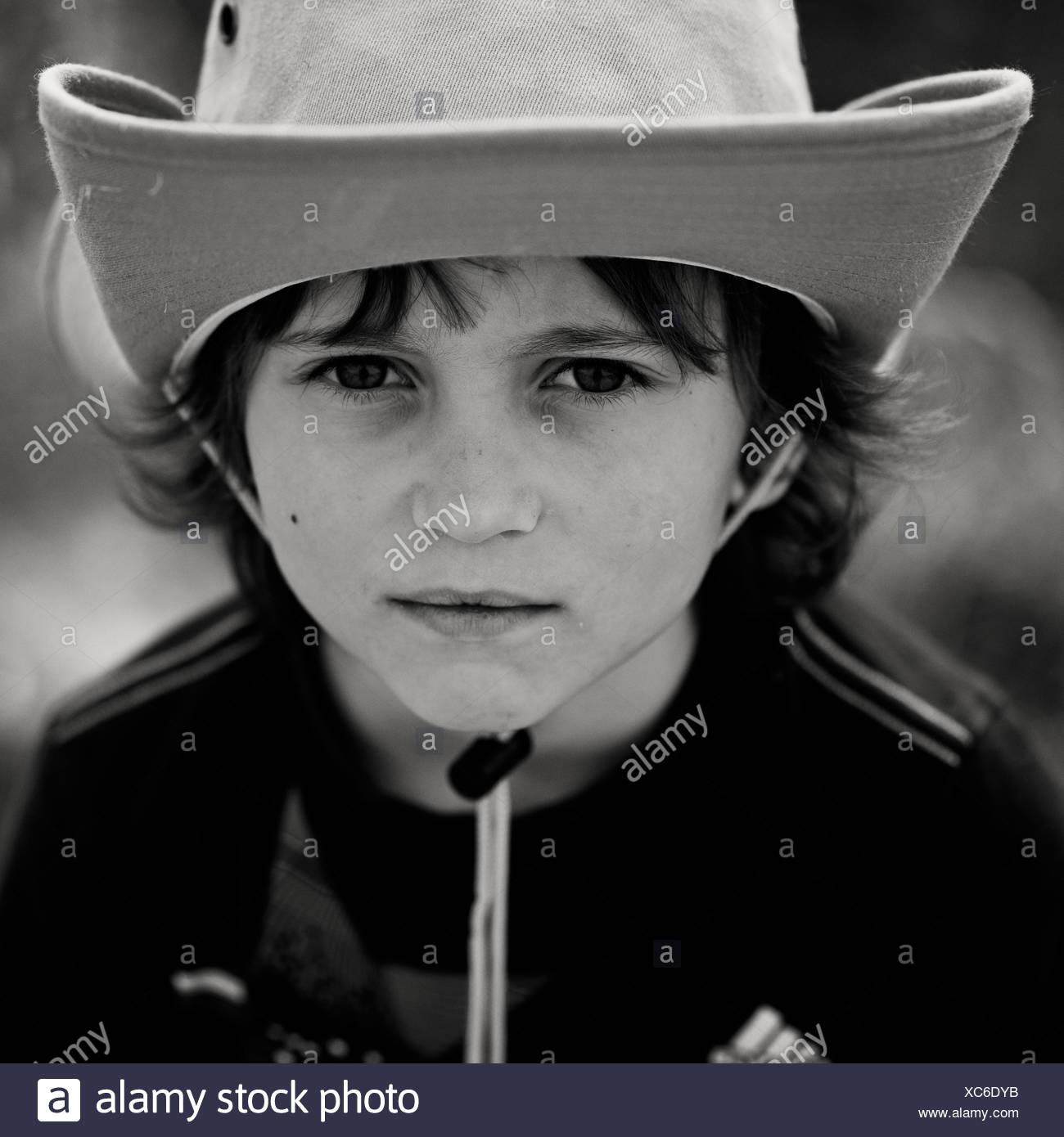 Portrait of boy (6-7) wearing cowboy hat Stock Photo  282884431 - Alamy 0246dc380330