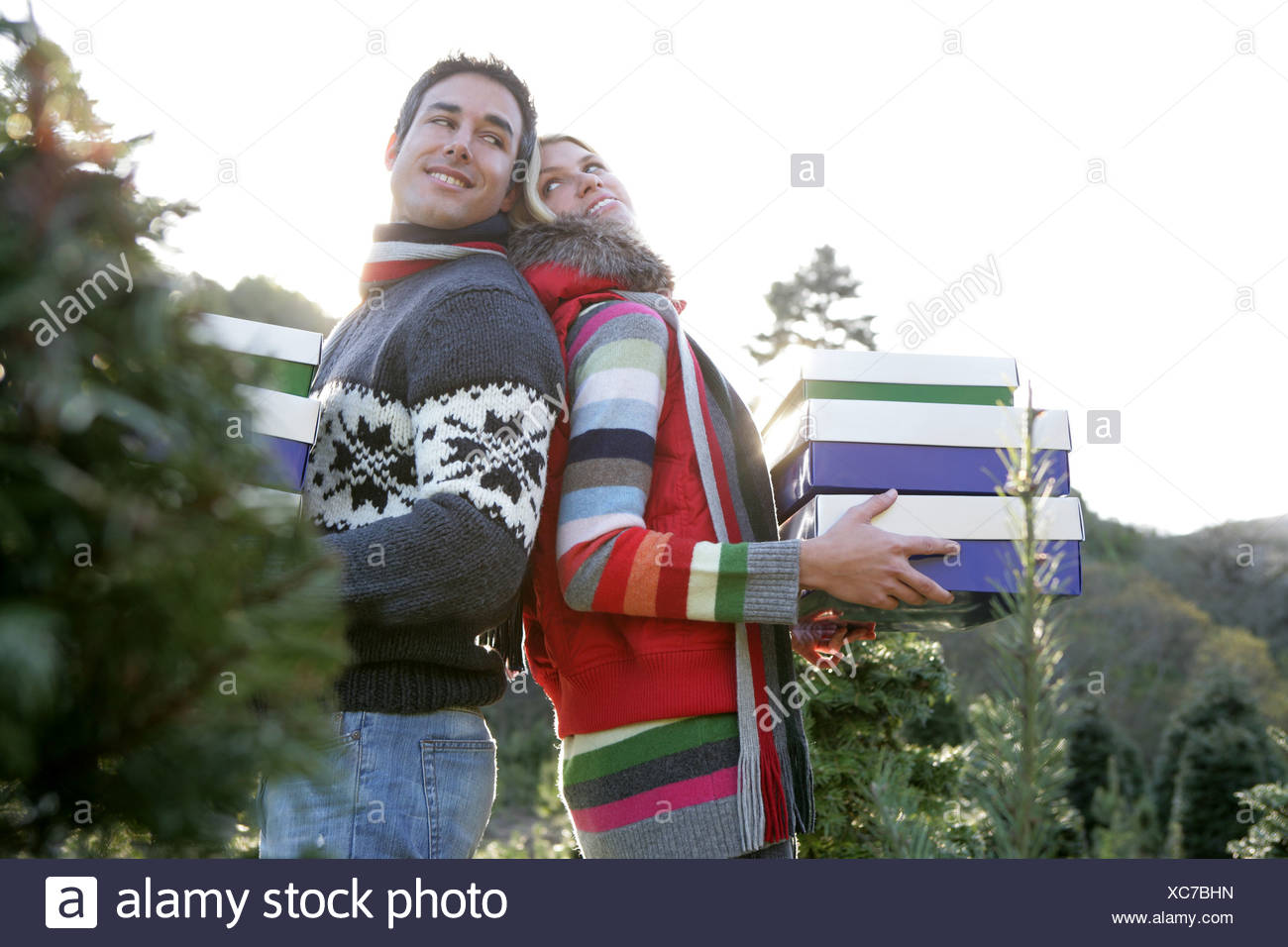 Young couple with Christmas gifts outdoors Stock Photo: 282904545 ...